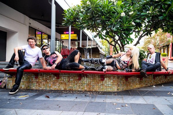 The HIt'N'Mizz band laying on public seating